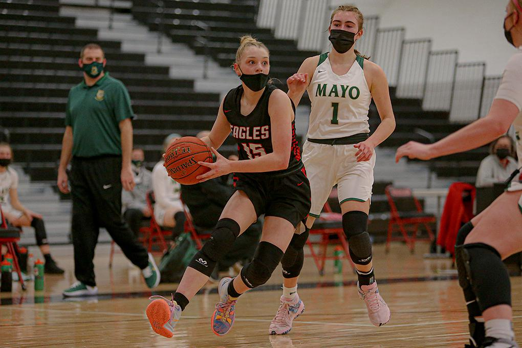 Eden Prairie eighth-grader Tori Schlagel (15) drives to the basket as Rochester Mayo's Hannah Hanson (1) looks on. Schlagel scored a career-high 14 points in the Eagles' victory. Photo by Mark Hvidsten, SportsEngine