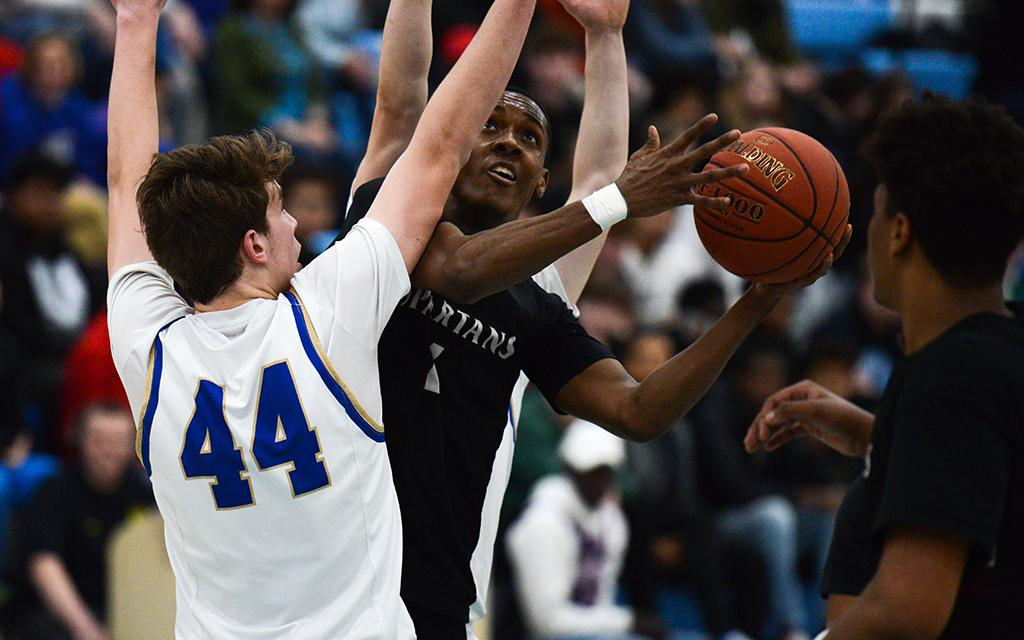 Richfield senior Jeff Moore eyes the basket against Holy Angels in the Class 3A, Section 3 championship at Bloomington Jefferson High School on Thursday. Photo by Carter Jones, SportsEngine