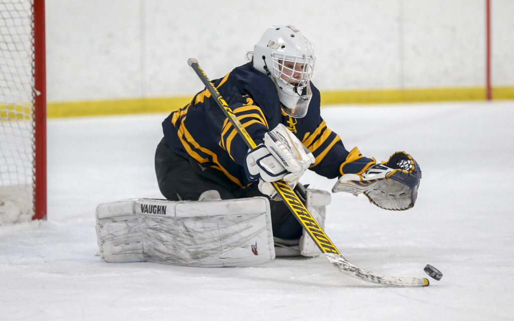 Irish goalie William Tollefson stretches to pull in a rebound late in the third period against Lakeville North. Tollefson had 20 saves in the Irish's 3-1 victory over the Panthers. Photo by Jeff Lawler, SportsEngine