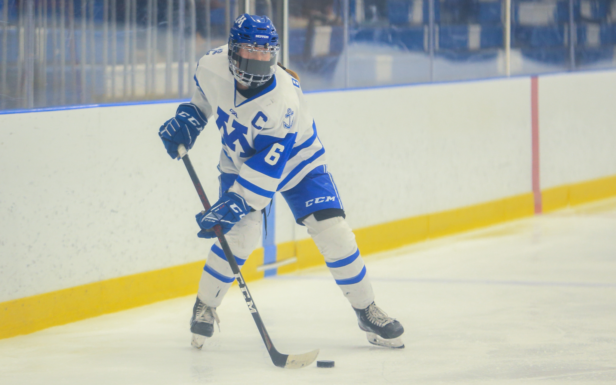 Minnetonka's Hanna Baskin (6) looks for a passing lane during a Skippers' power play against Holy Family Catholic Saturday. Baskin opened the scoring in the Skippers' 4-1 victory over the Fire. Photo by Jeff Lawler, SportsEngine