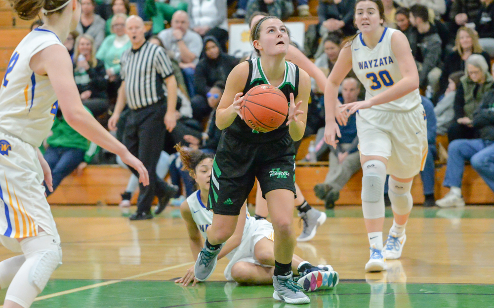 Hill-Murray's Vanessa Wren drives through the defense in the second half. The Pioneers suffered their first loss of the season, falling to the Trojans 67-42 at home. Photo by Earl J. Ebensteiner, SportsEngine
