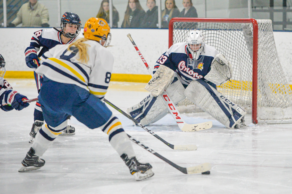 Breck's Sadie Lindsay picks up a goal in the second period in the Class 1A, Section 5 final Wednesday night, helping the Mustangs beat Orono 6-2 at the St. Louis Park Rec Center. Photo by Earl J. Ebensteiner, SportsEngine
