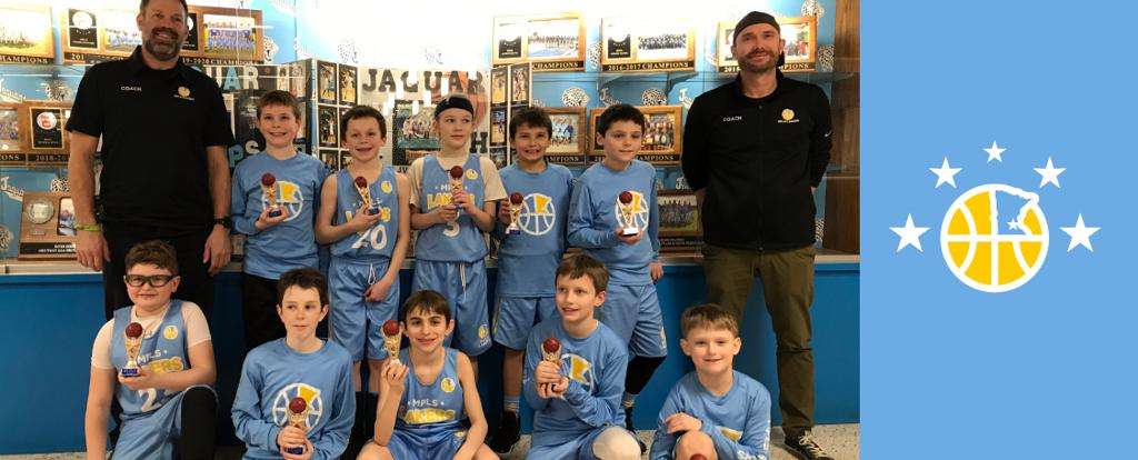 Mpls Lakers Youth Traveling Basketball Program Inc Boys 4th Grade Blue pose with their Trophies after becoming the Champions at the Bloomington Winter Shootout tournament in Bloomington, MN