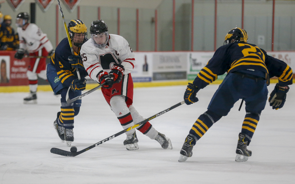 Lakeville North senior Shane Griffin tries to split two Rosemount defenders Tuesday night at Ames Arena. The Panthers fell to the Irish 3-1. Photo by Jeff Lawler, SportsEngine