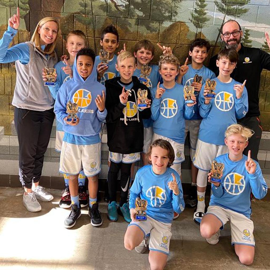 Mpls Lakers Youth Traveling Basketball Program Inc Boys 5th Grade Gold pose with their Trophies after becoming the Champions at the St Paul Winter Shootout tournament in St Paul, MN