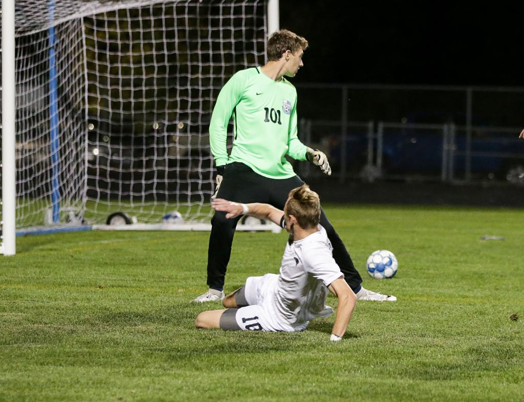 William Heinen (10) slides the ball past goalkeeper Parker Dahlman (101) for a goal late in the second half. Champlin Park defeated Blaine 6-1 to capture the Northwest Suburban Conference title on Tuesday night. Photo by Cheryl A. Myers, SportsEngine