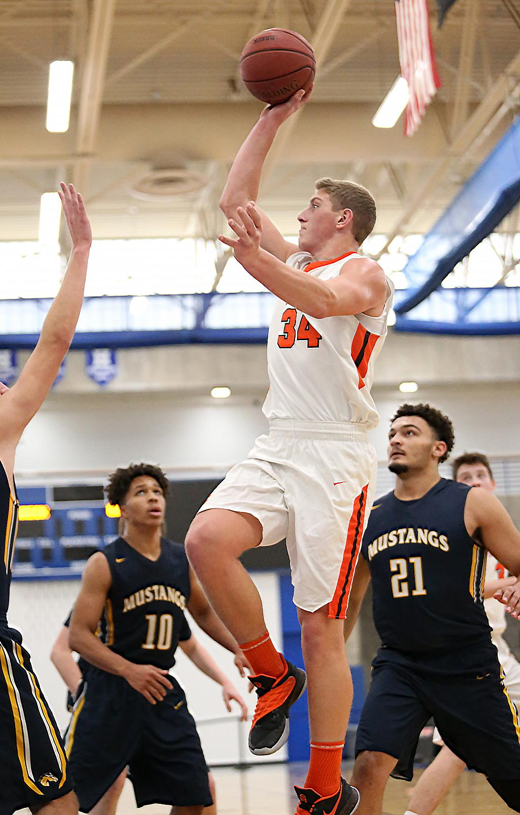 Reid Gastner (34) led the Tigers scoring with 19 points, including five three-pointers. Lake City fell to Breck 57-52 at Hopkins High School on Saturday afternoon. Photo by Cheryl Myers, SportsEngine
