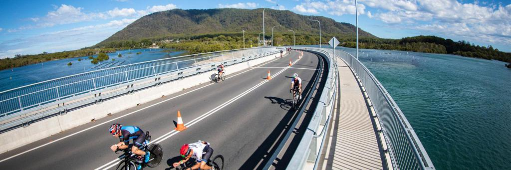 Cyclists participating in IRONMAN 70.3 Port Macquarie