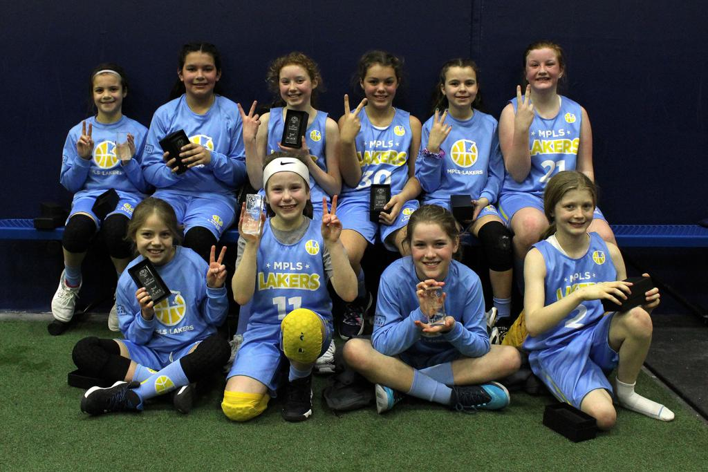 Minneapolis Lakers Girls 5th Grade Gold pose with their hardware after taking 2nd Place at Blaine Girls Invitational in Blaine, MN