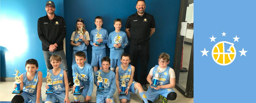 Minneapolis Lakers 4th Grade Blue pose with their trophies after earning 3rd place at the Hastings Spiral Classic tournament in Hastings, MN