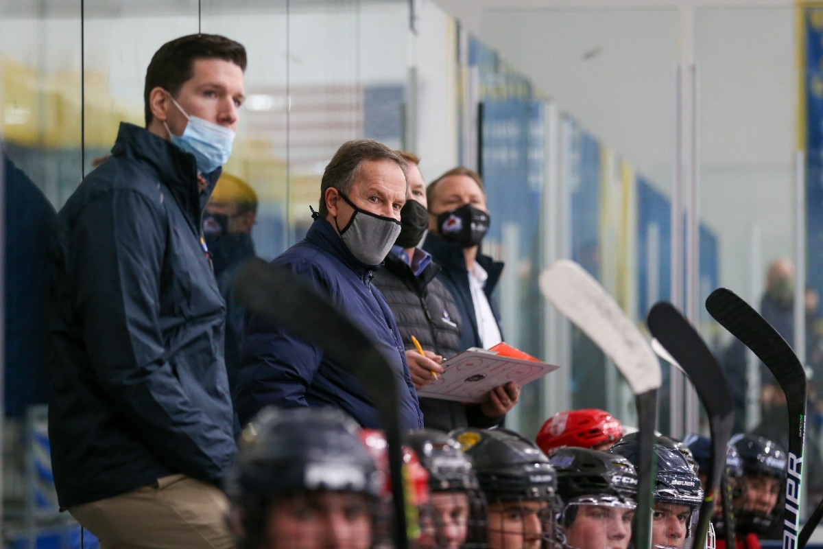 Team Colorado coach George Gwozdecky (in gray mask) watches on as his players compete in their first CCM High School NIT game on April 22. Team Colorado won one of its four matchups at the tourney in Minnesota. Photo by Jeff Lawler, SportsEngine