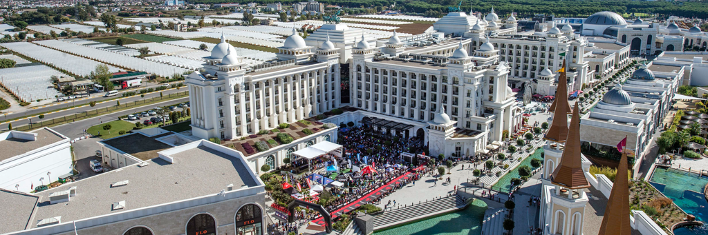 "The impressive finish line of IRONMAN 70.3 Turkey in the famous theme park ""Land of Legends"" with massive spectators in Belek"