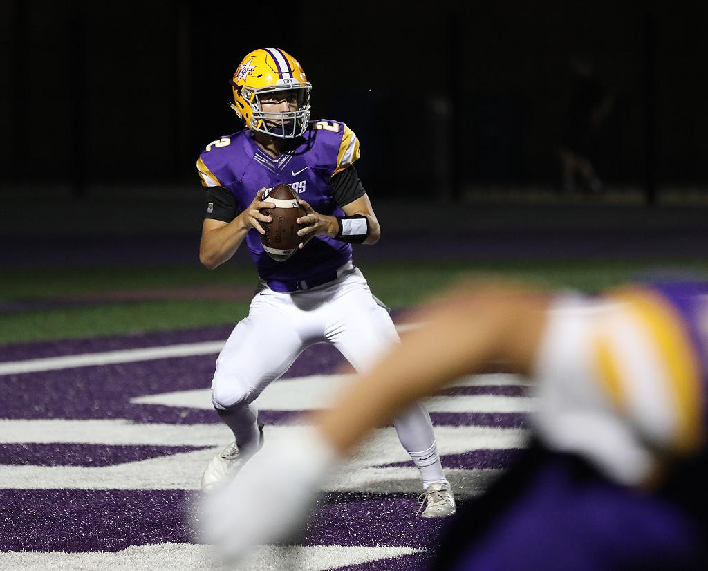 Cretin-Derham Hall quarterback Preston Thelemann drops back in to the end zone, looking for an open receiver. Thelemann finished with 290 passing yards, leading the Raiders to a 24-14 win over the Raptors. Photo by Cheryl A. Myers, SportsEngine