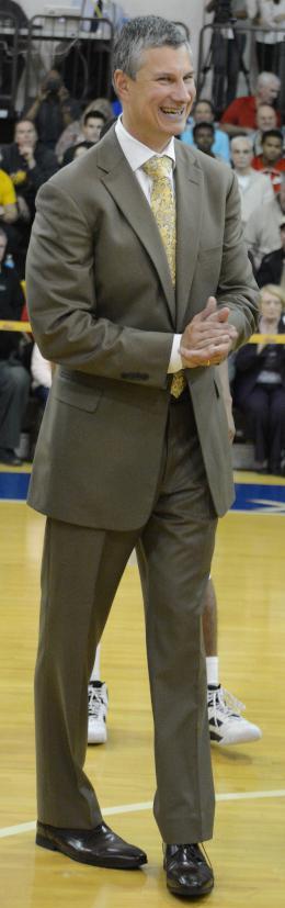 John Giannini smiling on the court