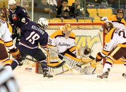 Tyler Kelleher looks for a rebound in front of the Bulldog net. Photo by