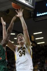 Seven-foot-one freshman center Adam Woodbury brings size, skill to Iowa. (Photo: David Scrivner / Press-Citizen)