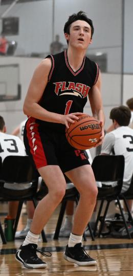 Gavin Cote prepares to shoot the basketball
