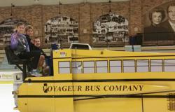 Campers Brooklyn & Michael Durfee join Tim Kowalik on an ice resurfacing trip around Sill Arena.