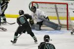 Southlake's Louie Guarino (#8) fires off a shot at Sam Biks (HP)