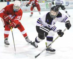 Buffalo junior Blake Habisch looks for a rebound opportunity. He registered a goal and 3 assists to lead the Bison to a 7-0 home win over the Vikings. (Photo by Rob LaPlante)