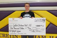 Will Burke '20 is pictured with the TruStone Financial $1000 check paid to CDH.