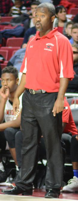 Imhotep head coach Andre Noble watches his team from the sidelines