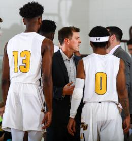 Joe Crispin talks with Rowan basketball players