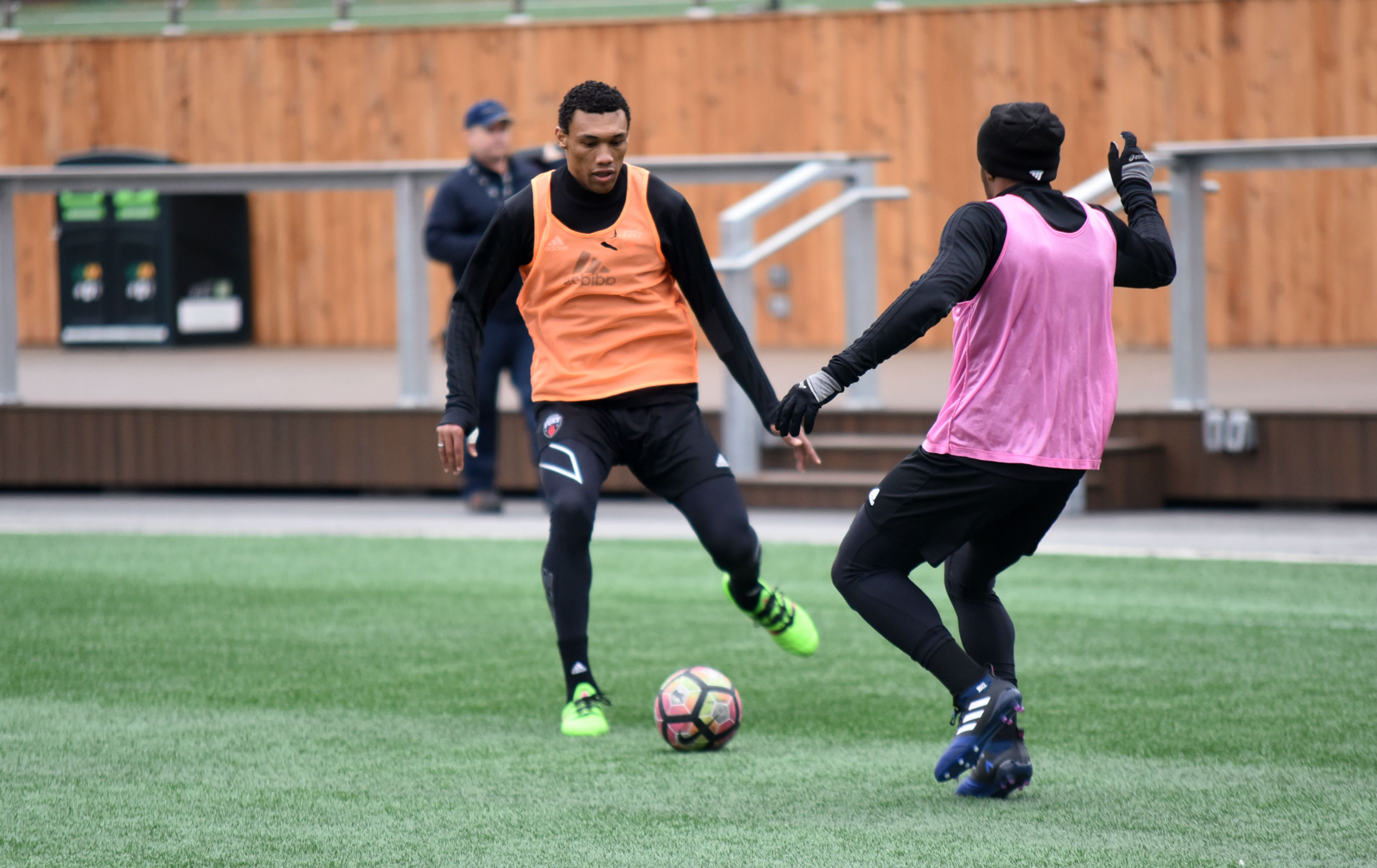 Steevan Dos Santos with the ball at his feet, with a defender in front of him, at training