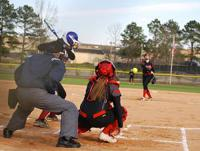 Softball batter waiting for pitch to reach the plate during a game