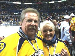 Herb & Barbara Fritch, sporting Nashville Predators jerseys, taking their seats among the crowd in Nashville's Bridgestone Arena