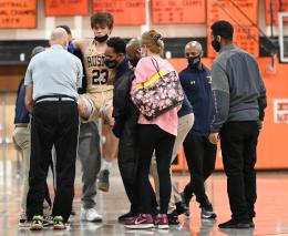 A Rustin Play is carried away by coaches