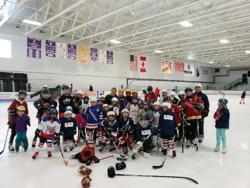 "Several players helped mentor young girls participating in the ""Try Hockey for Free"" program"