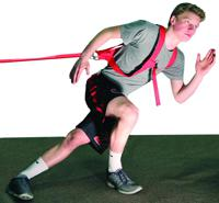 Work at mastering corners with crossover strides by getting a good knee bend while pulling against resistance.