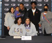 Tamia Ugass, seated at left, with family after signing her letter of intent to LSU. (submitted photo)
