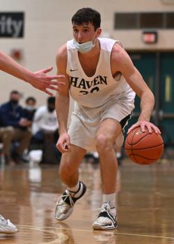 Luke Edwards dribbles a basketball