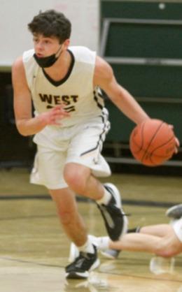 Teddy Spratt dribbles a basketball